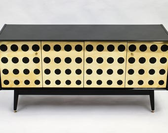 Re-modeled G Plan sideboard with brass circles
