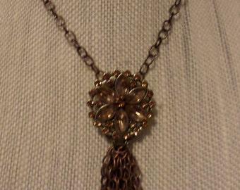 Brown gemstone necklace with chain tassle