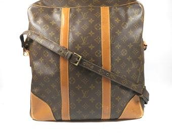 Authentic Louis Vuitton bag. Louis Vuitton messenger bag. Louis Vuitton travel bag. Louis Vuitton handbag.
