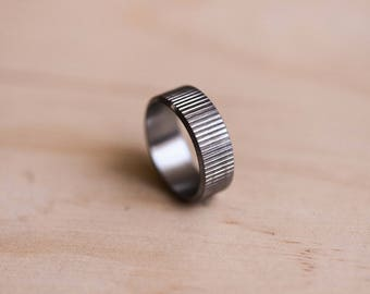 Straight Line Knurled Stainless Steel Ring with a Brushed Finish