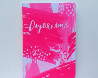 Pink and white illustrated A6 notebook