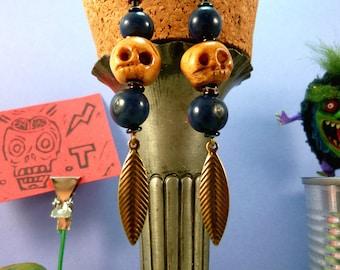 Earring Voodoo - skulls, bones, Acai seeds, beads, and sheet metal.