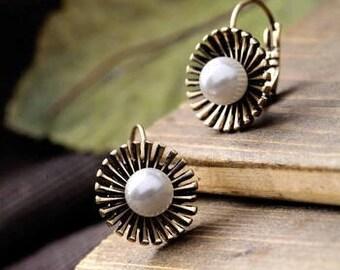 Dandelion flower pearl earrings.