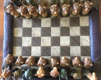 full chess set with wild animal pieces and board