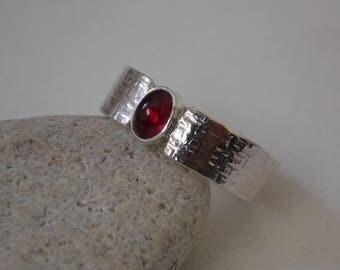 Silver hammered set tourmaline stone ring.