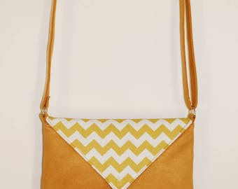 Zig zag yellow clutch bag