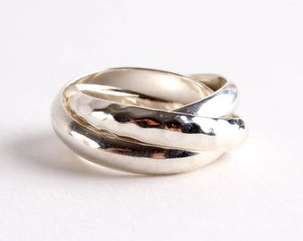 Silpada ring, sterling silver of three interlocking bands, size 5  PRICE REDUCED