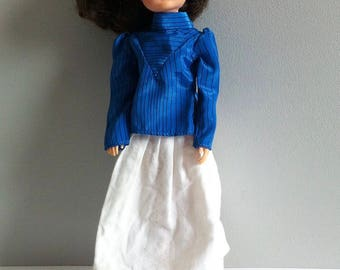 1980's Sindy clothes, rainy days skirt, blue blouse and sun hat.