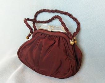 cocoa / 1940s chocolate brown purse with twist handles and clear plastic clasp