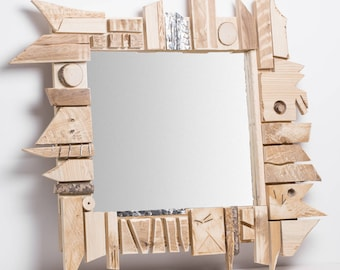 Ongle. Abstract mirror, wood and aluminum frame, cuts polygonal of antique furniture.