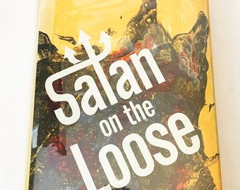 Satan on the Loose.  Vintage book by Nicky Cruz circa 1973. Occult.  Voodoo.  Witch doctor.  Fiction literature.  Finding spirituality.