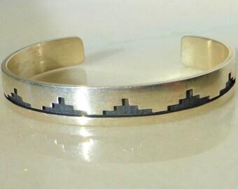 Raymond Kyasyousie Hopi Overlay Cuff Bracelet in Sterling Silver.