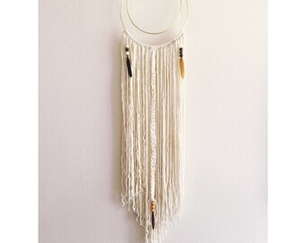 Neutral hoop yarn wall hanging with feathers and beads