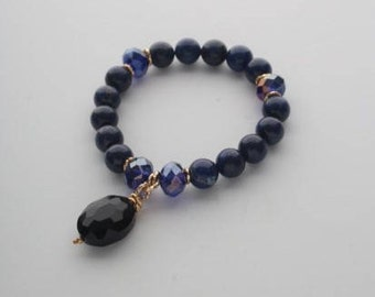 Bracelet with blue lapis lazuli and glass crystal.  Natural stones 10mm