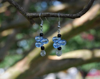 Blue tear drop glass bead earrings with black accent beads and silver wire. Nickel free earring hooks.