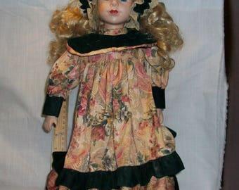 Listing 221 is a Vintage Porcelain Doll