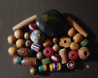 34 glass African beads, bauxite, Horn, wood, seed and terracotta