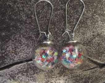 Small earrings dangling silver stud earring hooks made from a glass globe with stars and multicolored