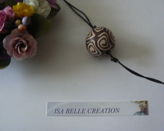 beige with spiral patterns Brown ball necklace