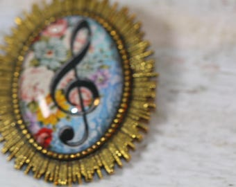 digital image and glass cabochon brooch