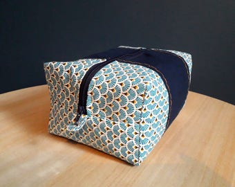 Yellow patterned blue pouch
