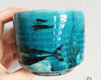 Turquoise ceramic cup with whale and sperm whale in a gift box.