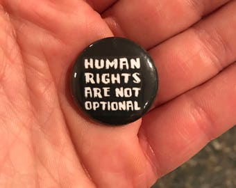 "1"" button Human Rights are not Optional"