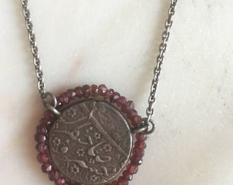 Silver coin necklace with garnet bead around