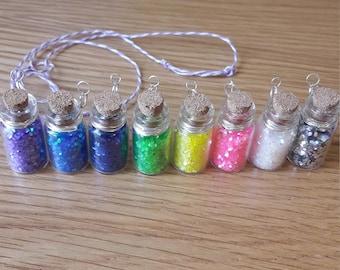 Pixie fairy dust jar pendant. Glitter filled tiny jar pendant with multi coloured adjustable twine necklace. Fairy jewellery. Mermaid jewels