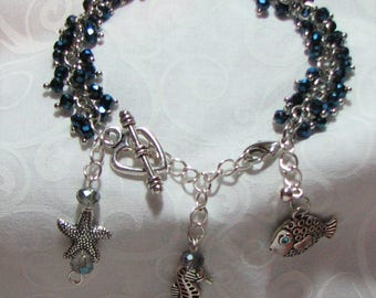 blue beaded ocean charm bracelet.