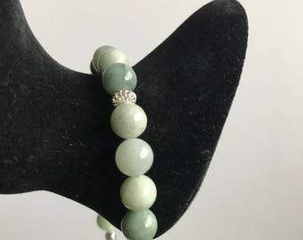 Jadeite beaded bracelet with sterling silver decorative beads