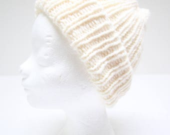 Handmade knitted hat in rib with wide edge