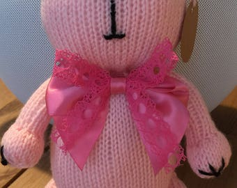 Knitted pink cat
