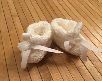 White newborn baby booties