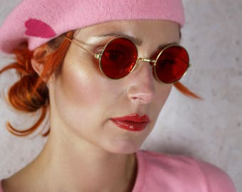 60's 70's round red lense John Lennon sunglasses with silver or gold frames hippie