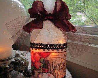snowmen,snowman,primitive,primitive snowmen,wine bottle light,wine bottle lights,wine bottle lamp,lamp,lighted glass bottles,lighted bottles