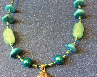 Blue and Green Glass rocaille and plastic bead fish charm 18 inch necklace