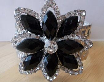 Silver Tone Cuff Bracelet with a Black Crystal and Clear Rhinestone Brooch