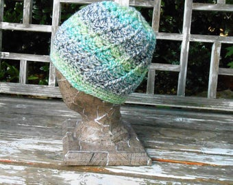 """Spiral, blue-green, multi color beanie. 24"""" around will fit medium-large size. Soft and well made will last for years. Machine wash and dry."""