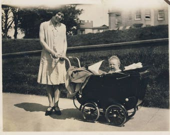 Vintage photograph of woman with infant in pram c1920s