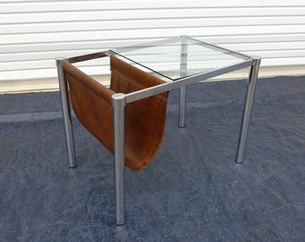 chrome and glass end table with brown leather like magazine sling mid century modern side table