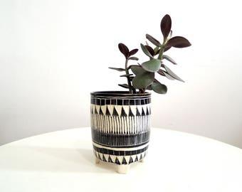 Black and white geometric carved ceramic planter, tripod planter