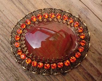 Vintage orange rhinestone brooch