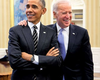 Barack Obama jokes with Vice-President Joe Biden in the Oval Office on February 9, 2015.