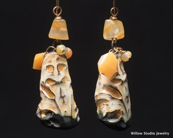 O Helios, sunny earrings made of art ceramics, yellow opals (plain and Ethiopian,) hand cut agates and 14K GF wire.  Very one of a kind.