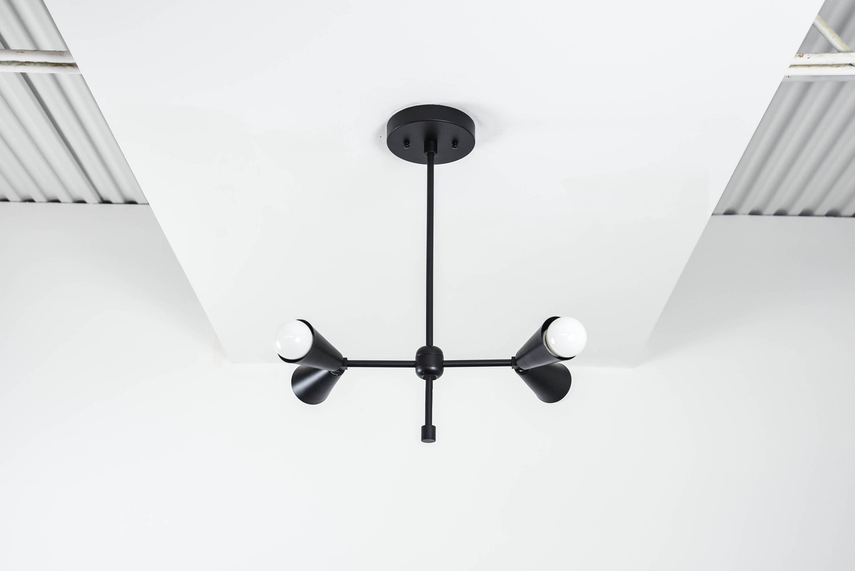 Free shipping modern chandelier matte black 2 arm 4 light modern chandelier matte black 2 arm 4 light pinwheel bulb sputnik mid century industrial hanging light ul listed arubaitofo Gallery