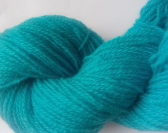 Wild Blue Yonder. Approx 40 grams of sport weight yarn, 100% wool.
