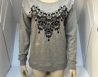 GLITTERY hand embellished SWEATSHIRT. Grey women's organic cotton, sweater with a textural, glittery black print and monochrome applique.