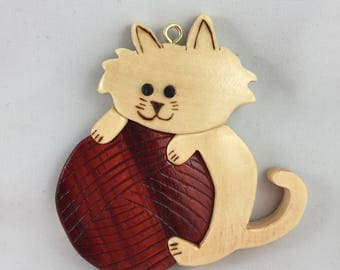White Cat With Yarn Ornament
