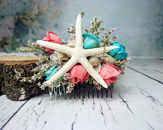 Beach wedding hair comb with starfish, sea shells and sola flowers in turquoise and coral reef